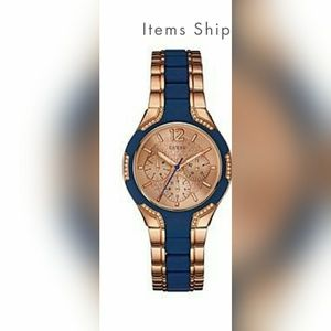 GUESS blue and rose gold tone watch